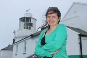 "At Whitby high lighthouse with my ""Trinity House green"" cardigan"
